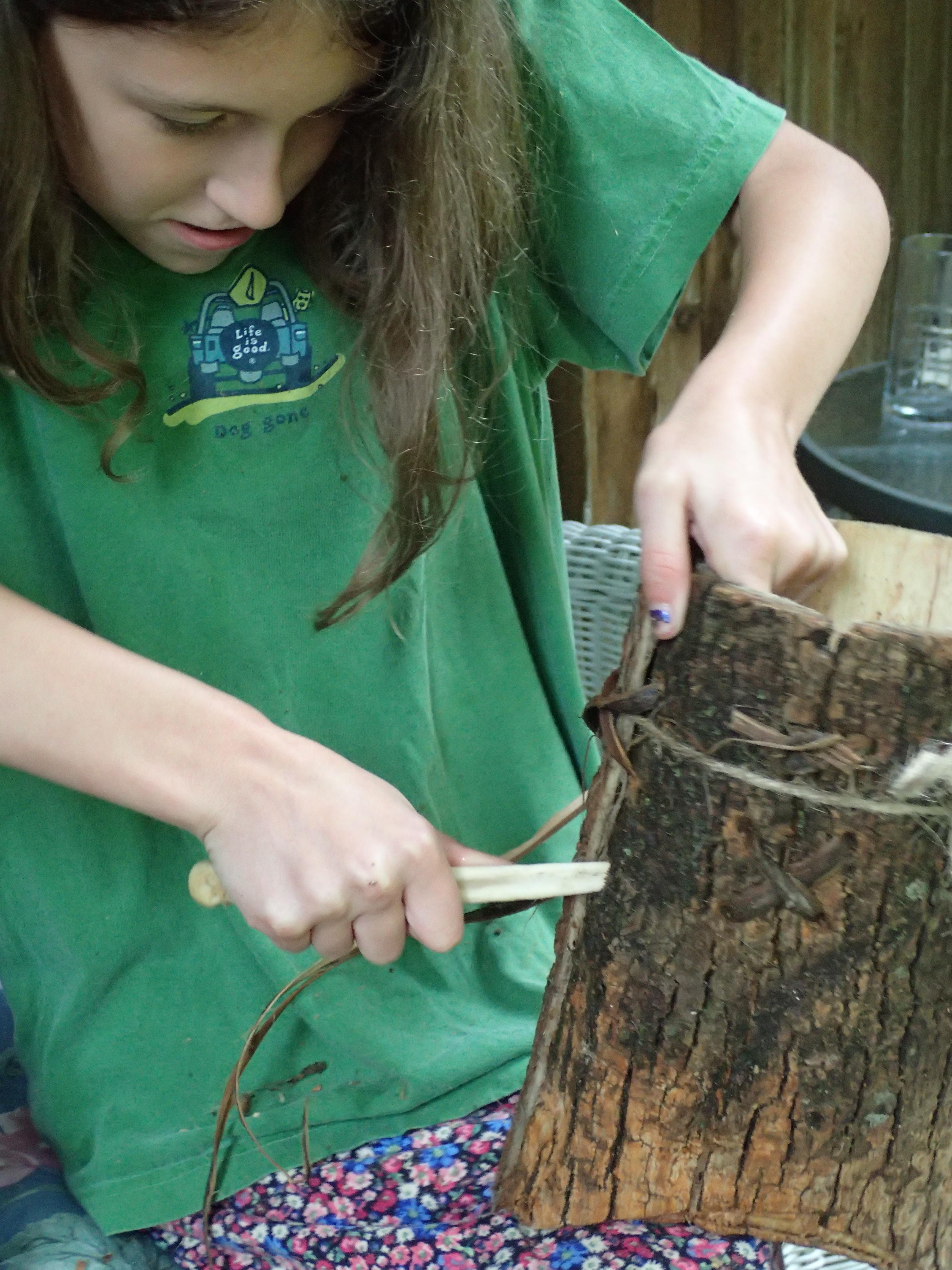 Gabby making stiching holes in bark bucket