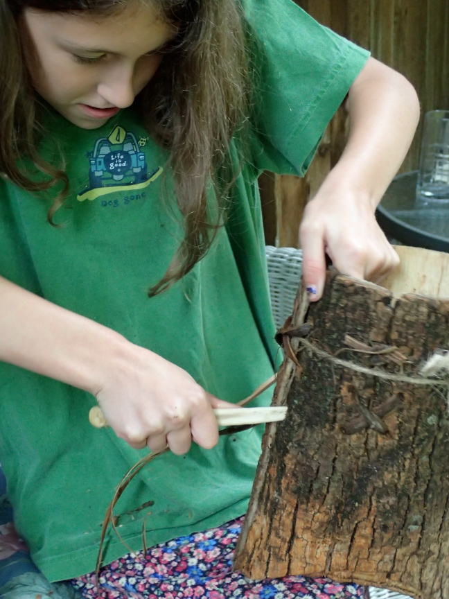 Gabby making stiching holes in bark bucket