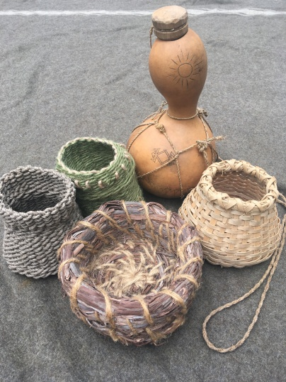 Twined and coiled baskets with gourd canteen